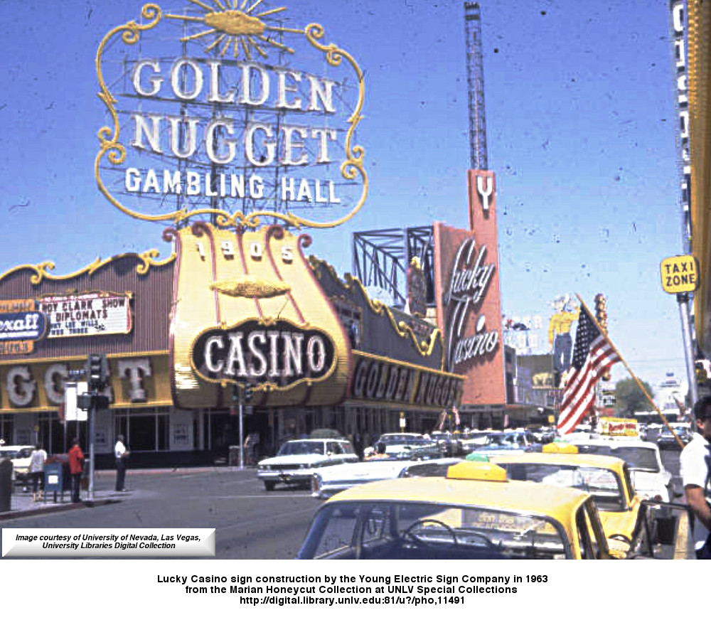 Below is a rare color photo of the Lucky Casino sign construction by the Young Electric Sign Company 