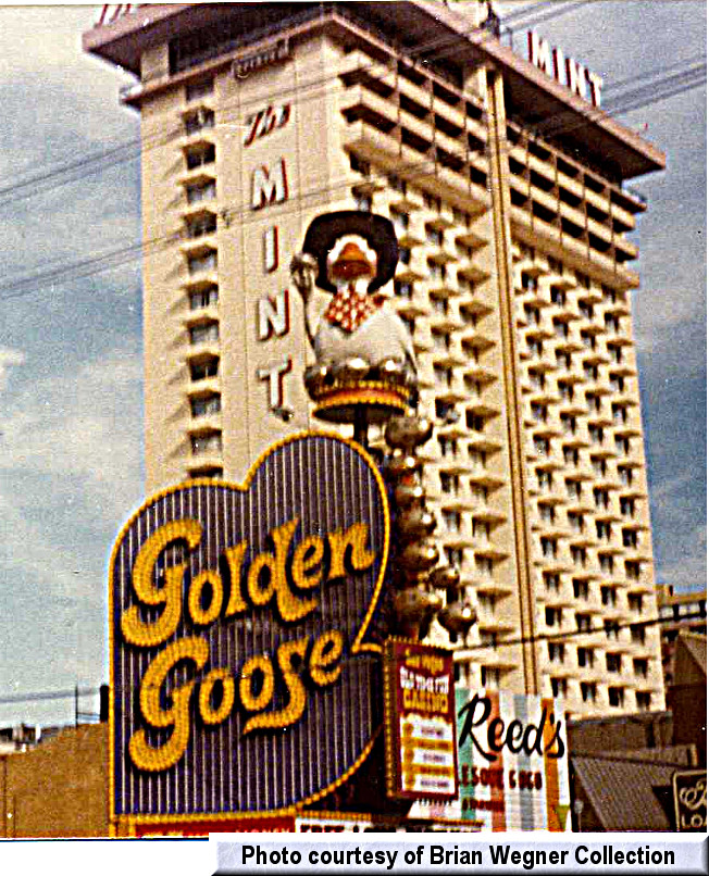 Mr. Reed's dwarfed by the Mint tower and tucked in next to the Golden Goose.